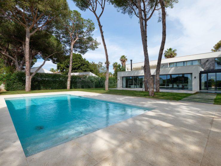 Top quality contemporary villa front line beach